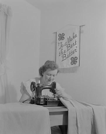 Woman demonstrating sewing